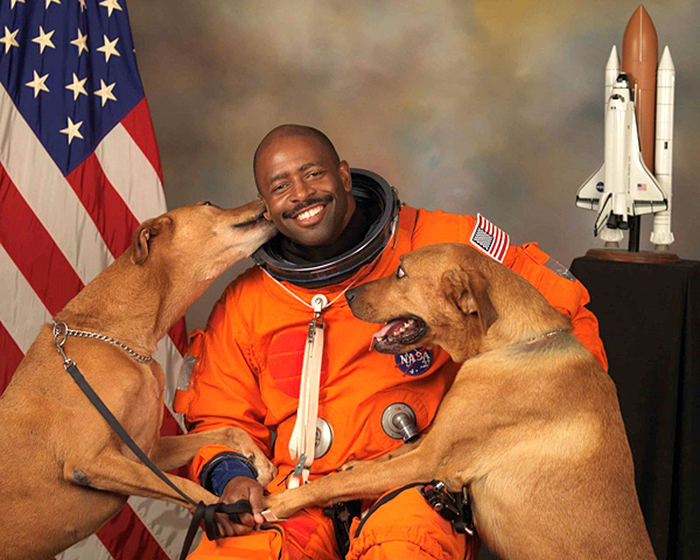 NASA astronaut Leland D Melvin with his dogs Jake and Scout