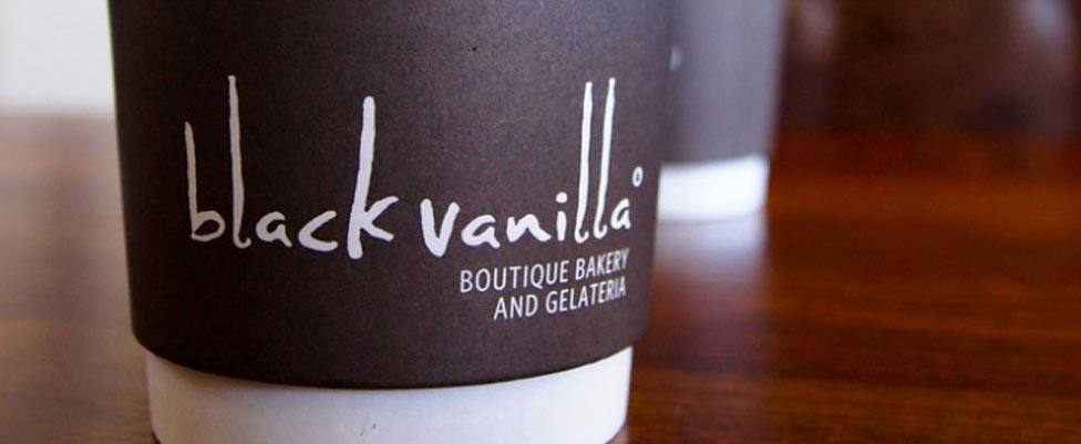 Black Vanilla Logo Design on Coffee Cup