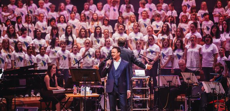russell-watson-sings-with-the-ac-academy-choir-logo-design