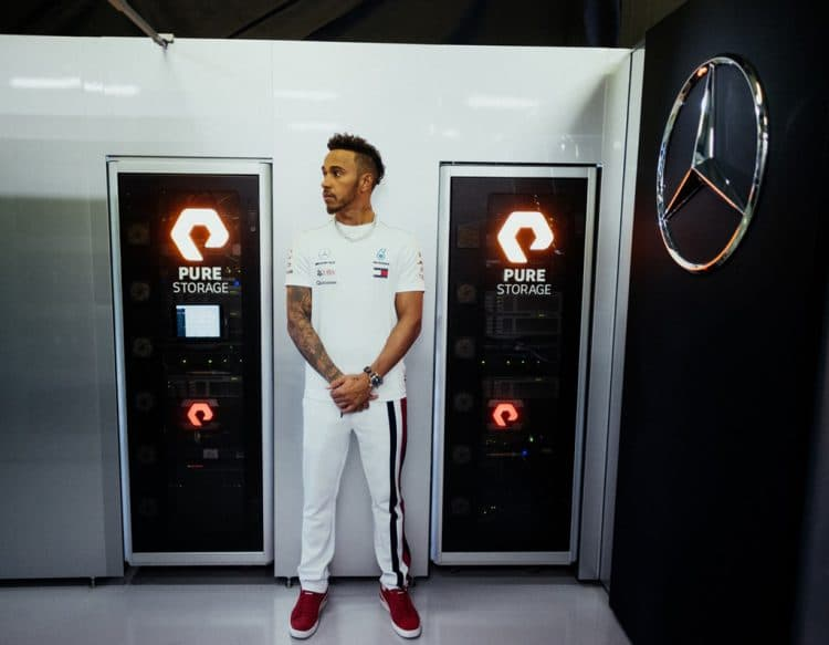 Lewis Hamilton next to PureStorage Logo Designed by The Logo Smith, used by the F1 Mercedes AMG Petronas Team
